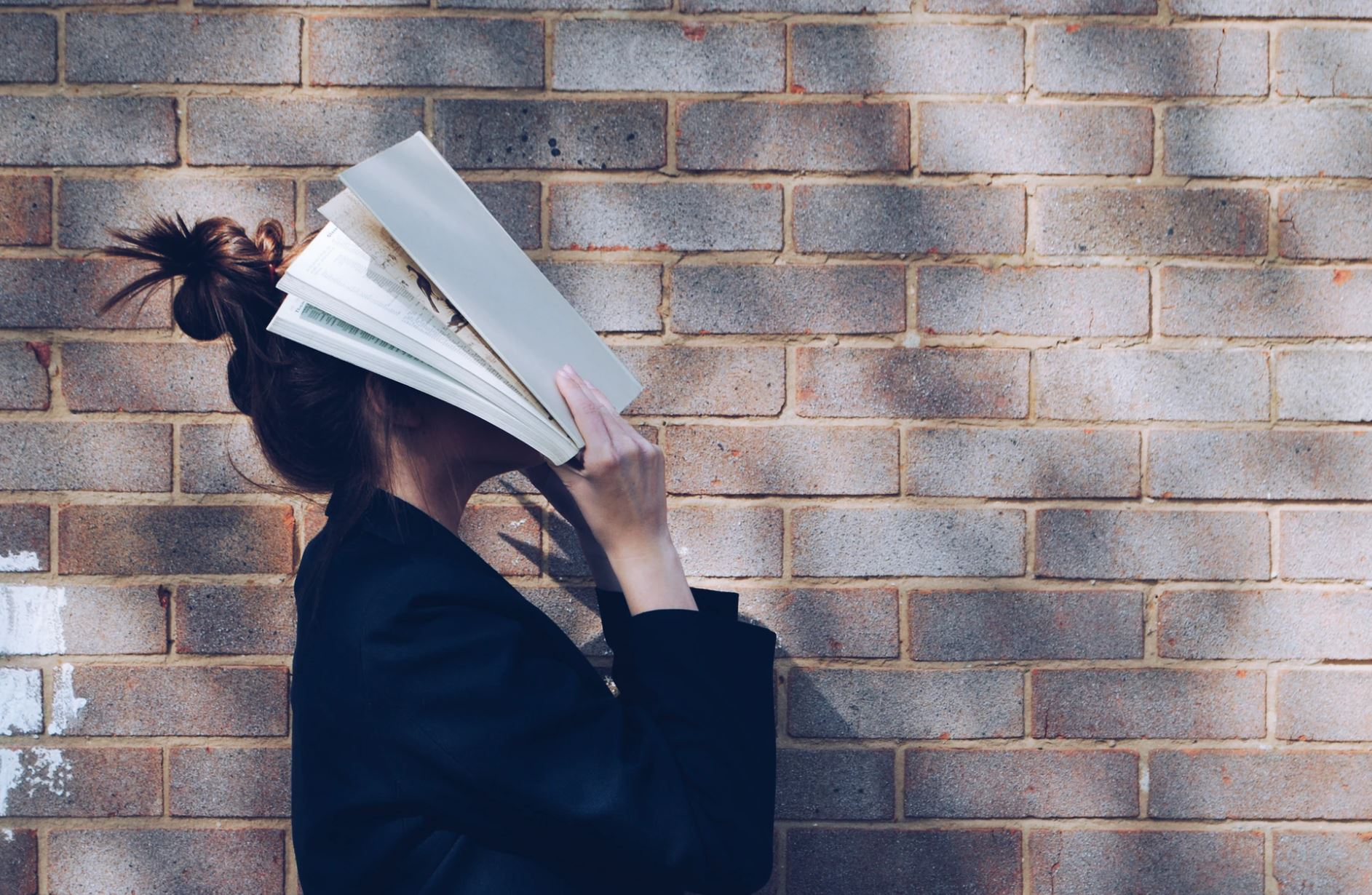 A student with a book | Siora Photography/Unsplash